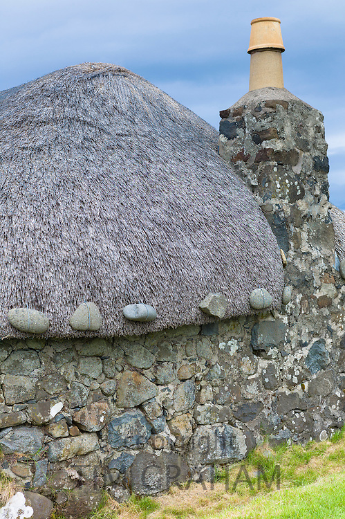 Tourist attraction Skye Museum of Village Life depicts thatched stone cottages in ancient crofting housing at Kilmuir, Isle of Skye, the Western Isles of Scotland, UK