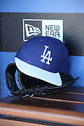 LOS ANGELES, CA - JUNE 17:  A baseball cap and glove sit in the dugout during batting practice before the Los Angeles Dodgers game against the Colorado Rockies at Dodger Stadium on Tuesday, June 17, 2014 in Los Angeles, California. The Dodgers won the game 4-2. (Photo by Paul Spinelli/MLB Photos via Getty Images)
