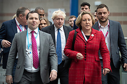 © Licensed to London News Pictures . 02/10/2018. Birmingham, UK. BORIS JOHNSON crosses a bridge with supporters on the way to a Conservative Home fringe event at the conference on day 3 of the Conservative Party conference at the ICC in Birmingham . Photo credit: Joel Goodman/LNP