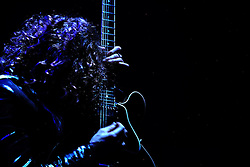 The post-punk band The Killers perform at the Hammerstein Ballroom at Manhattan Center Studios in New York, N.Y. on Oct. 24, 2008. Guitarist Dave Keuning plays a guitar during the performance.