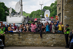 © Licensed to London News Pictures. 18/05/2017. Halifax, UK.  Pro Labour Party demonstrators wait outside the launch event for the Conservative Party manifesto at The Arches in Halifax, West Yorkshire. The Conservatives are the last of the three main parties to launch their manifesto ahead of a snap general election called for June 8, 2017. Photo credit: Ben Cawthra/LNP