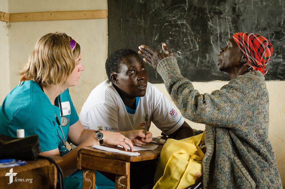 Amanda Ruback, a nurse from Florissant, Mo., attending Grace Chapel, listens to a patient describe her symptoms at the Mercy Medical Team clinic Tuesday, June 10, 2014, at the Luanda Doho Primary School in Kakmega County, Kenya. LCMS Communications/Erik M. Lunsford