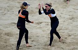 16-08-2014 NED: NK Beachvolleybal 2014, Scheveningen<br /> (L-R) Laura Bloem, Marloes Wesselink
