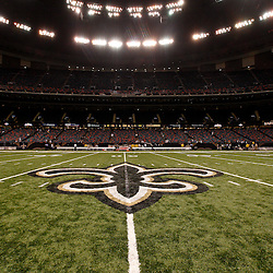August 27, 2010; New Orleans, LA, USA; A general view of the New Orleans Saints Fleur De Lis logo from the 50 yardline following a preseason game at the Louisiana Superdome. The New Orleans Saints defeated the San Diego Chargers 36-21. Mandatory Credit: Derick E. Hingle
