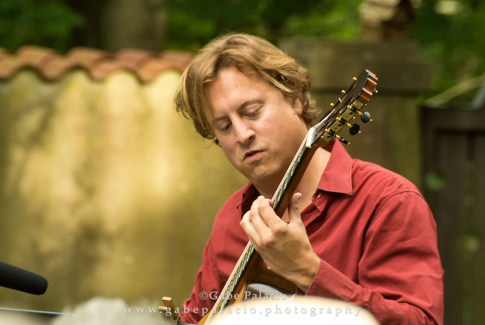 Jason Vieaux performs in the Sunken Garden at the Caramoor International Music Festival in Katonah New York on June 24, 2012..(photo by Gabe Palacio)