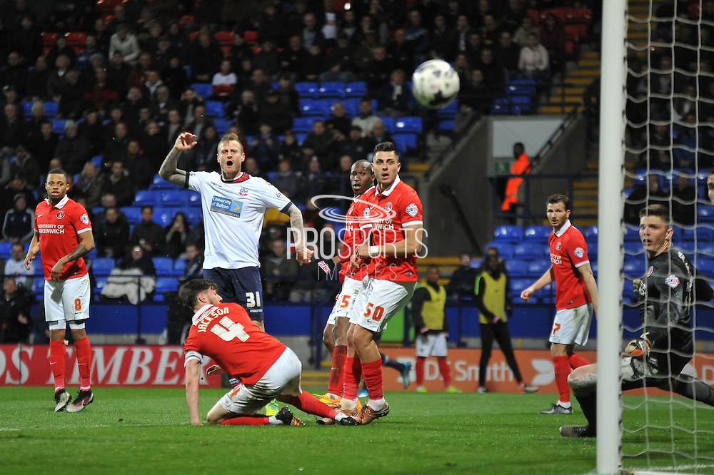 Bolton Wanderers defender, David Wheater (31) just wide with the shot on goal during the Sky Bet Championship match between Bolton Wanderers and Charlton Athletic at the Macron Stadium, Bolton, England on 19 April 2016. Photo by John Marfleet.
