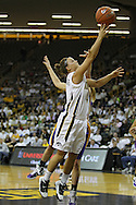 December 22 2010: Iowa guard Megan Considine (4) puts up a shot past Northern Iowa guard Rachel Madrigal (3) during the first half of an NCAA college basketball game at Carver-Hawkeye Arena in Iowa City, Iowa on December 22, 2010. Iowa defeated Northern Iowa 75-64.