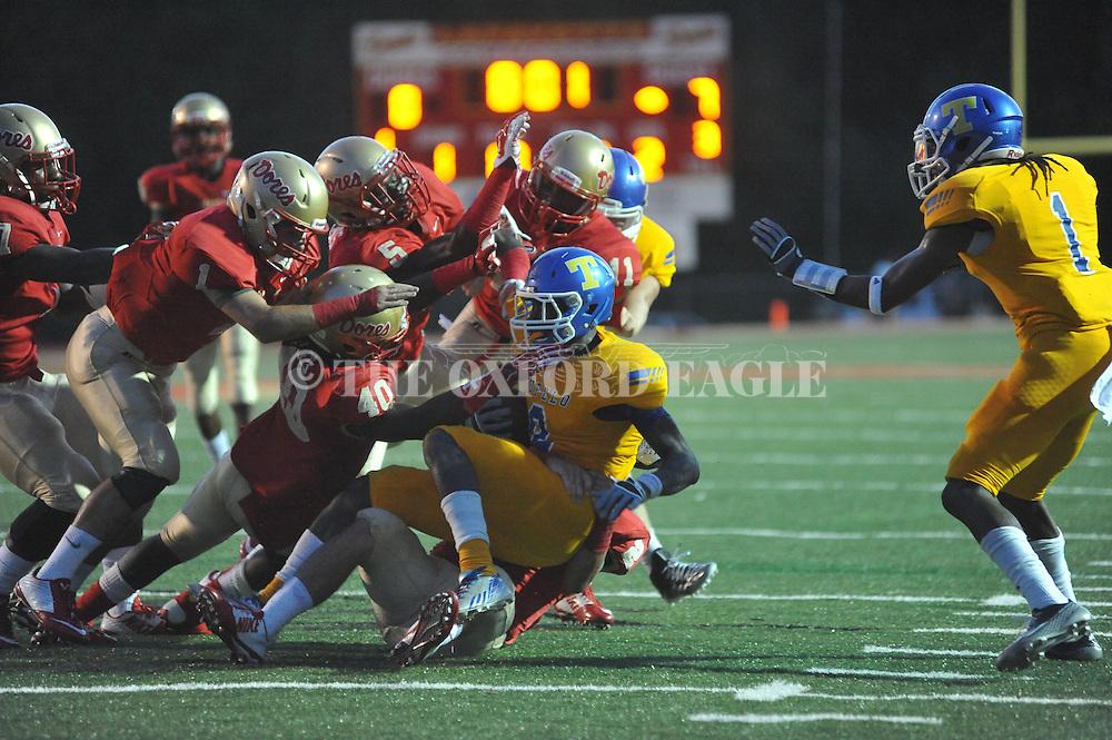 Lafayette High's Darren Toles (40), Lafayette High's Rashun Rockette (11), Lafayette High's Zeke Liggins (5), Lafayette High's John Murphree (1), and Lafayette High's Eli Murphree (2) tackle Tupelo's Deamio Garmon (8) in Oxford, Miss. on Friday, August 22, 2014. Tupelo won the season opener 20-0.