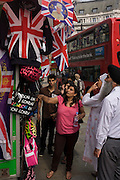 Asian tourists shop for royal souvenir merchandise in Oxford Street in the week of the Queen's diamond Jubilee celebrations.