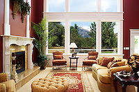 The livingroom of a home in the home show, with a great view of the golf course out the windows.