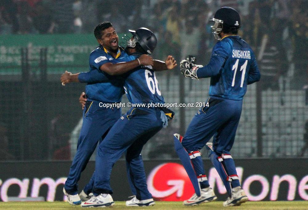 Rangana Herath celebrates with Pakistan team - ICC World Twenty20 cricket, Zahur Ahmed Chowdhury Stadium, Chittagong, Bangladesh. New Zealand v Sri Lanka, 31 March 2014. Photo: www.photosport.co.nz