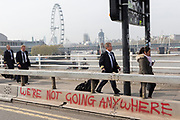 Airline pilots walk across the closed Waterloo Bridge on day 4 of protests by climate change environmental activists with pressure group Extinction Rebellion, on18th April 2019, in London, England.