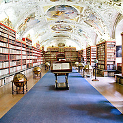 Strahov Library. Statue at left is of St. John the Evangelist. Book holder at right was specially designed for this library and keeps the books facing the reader as the wheel is turned.
