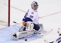 Mar 8; Newark, NJ, USA; New York Islanders goalie Evgeni Nabokov (20) makes a pad save during the third period at the Prudential Center. The Devils defeated the Islanders 5-1.