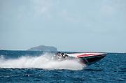 Cigarette boat speeding through the Virgin Islands.