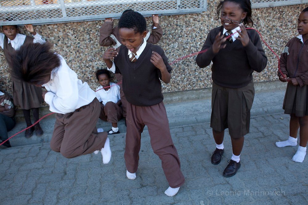 27 May 2009, Langa, Cape Town, South Africa. Children aged 12 - 14 years old from Siyabulela Primary School, attending the group set up by MAC Aids Fund SA Leadership fellow, Carmen Shadwell. She runs a project within two primary schools Siyabulela and Thembani, that addresses HIV risk behaviour in pre-adolescents in the transitional stage between primary and high school.