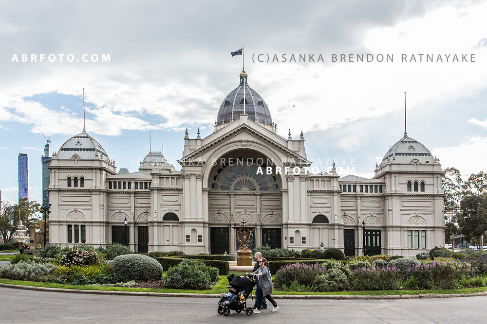 A mother pushes her child's pram in front of the Royal Exhibition building situated in the Carlton Gardens in Melbourne, Australia, September 1, 2017. On 9 May 1901, the Royal Exhibition building hosted the opening of the First Commonwealth Parliament of Australia. Asanka Brendon Ratnayake for the New York Times