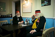 UNITED KINGDOM, Whittlesey: Straw Bear Festival. Straw Bear festival fans John (left) and Pete (right) enjoy a cup of tea in a local cafe during  the Straw Bear festival this weekend. The three day festival, which originated in 1882, consists of traditional Molly, Morris, Clog and Sword dancing as well as parading a large straw character known as 'The Bear' through the town. Rick Findler  / Story Picture Agency