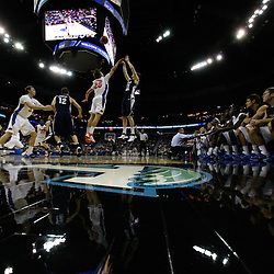 Mar 24, 2011; New Orleans, LA; Brigham Young Cougars forward Stephen Rogers (21) shoots over Florida Gators forward Chandler Parsons (25) during the first half of the semifinals of the southeast regional of the 2011 NCAA men's basketball tournament at New Orleans Arena. Florida defeated BYU 83-74.   Mandatory Credit: Derick E. Hingle