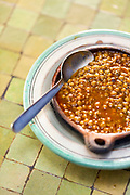 CHEFCHAOUEN, MOROCCO - 27th APRIL 2016 -  Close up of addas - Moroccan stewed lentils side dish, Chefchaouen - the blue city, Rif Mountains, Northern Morocco.