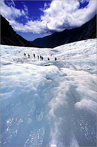 a group of trekkers make their way down the franz josef glacier near the end of a day hike.<br /> <br /> the franz josef glacier is on the western side of new zealand's south island.