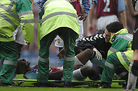 Credit: Back Page Images. Aston Villa v Fulham, FA Premiership, 23/10/2004. Darius Vassell (Aston Villa)) winces in pain as he is put onto the stretcher following his leg injury