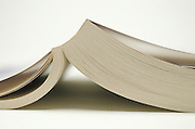 Opened book face down.