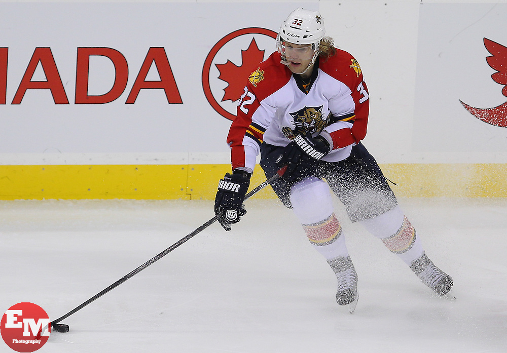 Feb 11; Newark, NJ, USA; Florida Panthers right wing Kris Versteeg (32) skates with the puck during the third period of their game against the New Jersey Devils at the Prudential Center. The Panthers defeated the Devils 3-1.