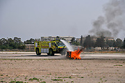 Israel Airport Authority fire truck extinguishes a fire during a demonstration. Photographed at the Haifa Airfield