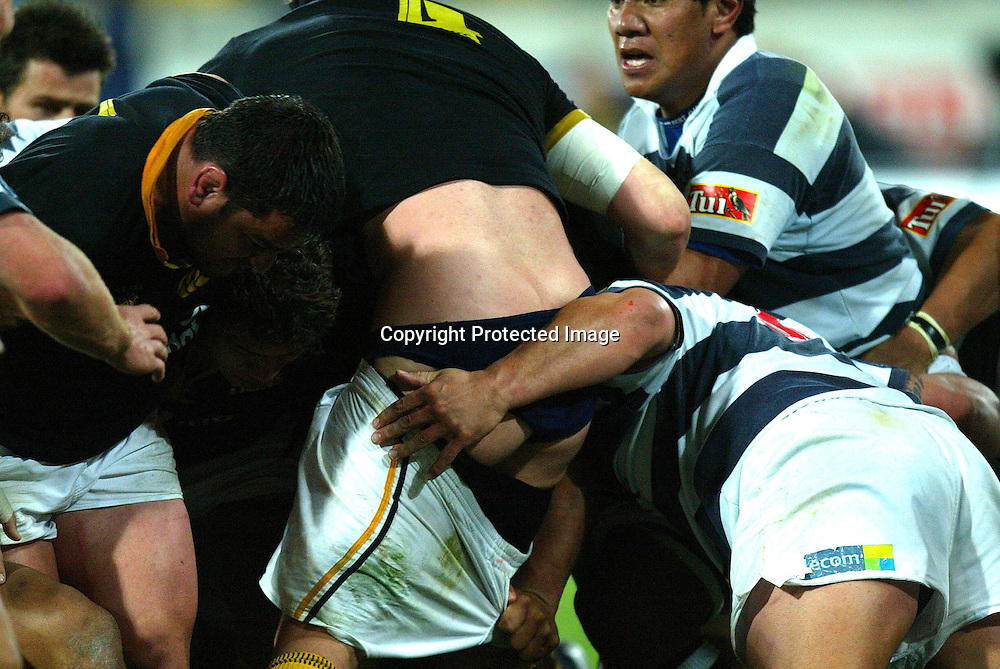 Auckland's captain Xavier Rush keeps a hand on things with Lion's Ross Kennedy during the Wellington Lions 27-21 win over Auckland on Saturday night at the Westpac Stadium, Wellington, New Zealand. NPC Div 1 <br /> 11 September 2004<br /> Photo: Marty Melville/Photosport