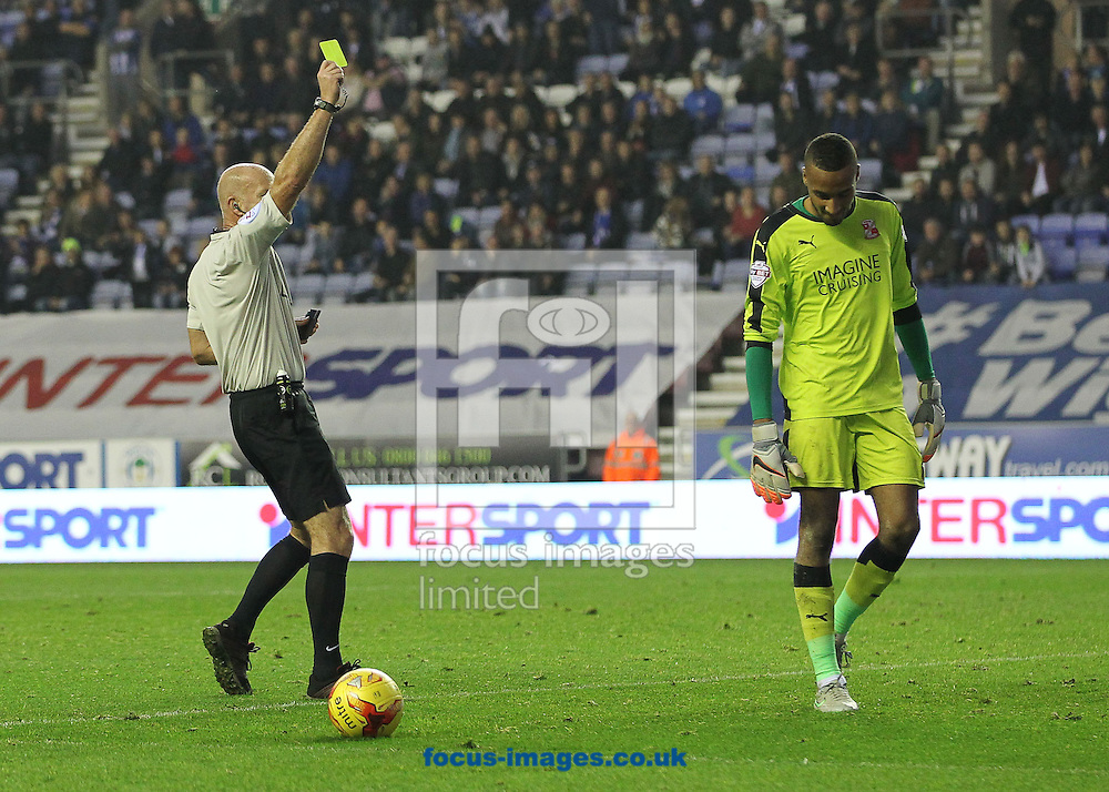 Referee, Nigel Miller books Lawrence Vigouroux of Swindon Town for time wasting during the Sky Bet League 1 match against Swindon Town at the DW Stadium, Wigan.<br /> Picture by Michael Sedgwick/Focus Images Ltd +44 7900 363072<br /> 31/10/2015