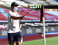 A corner flag is disinfected  during the Premier League match at the London Stadium, London. Picture date: 20th June 2020. Picture credit should read: David Klein/Sportimage