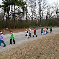 "Thomas Wells | Buy at PHOTOS.DJOURNAL.COM<br /> Marley Helms, left, is the classes ""pace car"" as her class enjoys the ""walking classroom"" on Thursday."