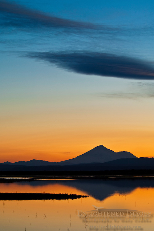 Sunset light and clouds over Mount Shasta reflected in Lower Klamath Lake, Lower Klamath National Wildlife Refuge, California