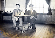 two men sitting indoors Japan ca 1940s