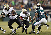New Orleans Saints running back Khiry Robinson (29) eludes a tackle attempt by Philadelphia Eagles inside linebacker DeMeco Ryans (59) as he runs the ball late in the fourth quarter during the NFL NFC Wild Card football game against the Philadelphia Eagles on Saturday, Jan. 4, 2014 in Philadelphia. The Saints won the game 26-24. ©Paul Anthony Spinelli