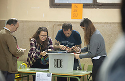 &copy; Licensed to London News Pictures. 01/10/2017. Barcelona, Spain.  <br /> <br /> Members of the organization setting the Sedeta de Gracia&acute;s Centre Civic poll station up, a while ago.<br /> <br /> Students, their parents, associations and neighbours have organized to carry out &quot;playful activities&quot; during the weekend and keep open the Sedeta de Gracia&acute;s Centre Civic.<br />  <br /> Since early in the morning dozens of people wait at the college&acute;s door for the voting time under the rain.<br /> <br /> Mossos d&acute;Escuadra said they won&acute;t do nothing if that can destabilize social order.<br /> <br /> Catalonia is awaiting for today, October 1st, when the Spanish Region wants to vote in a self-determination referendum to get a independence.<br /> <br /> The Referendum&acute;s Law was passed on last September 6th at the Catalonian Parliament thanks to the votes of &quot;Junts pel Sí&quot; and &quot;CUP&quot;. Then it was suspended by the Spanish Constitutional Court, on next day.<br /> Carles Puigdemont, the President of the Government of&nbsp;Catalonia, said he would ignore that and he and his Government will continue with the Referendum.<br /> <br /> The Spanish Government has sent to Catalonia thousands of &quot;Guardia Civil&quot; and &quot;Policía Nacional&quot; officers (two of the Spanish forces and state security forces), to enforce the ruling of the Constitutional Court and avoid the voting process on next Sunday. They will work with the Mossos d&acute;Escuadra (the Autonomic police in Catalonia).<br /> <br /> To avoid the vote, the Spanish Government has prevented the opening of polling stations, some of which are schools.  <br /> <br /> Photo credit: Gustavo Valiente/LNP