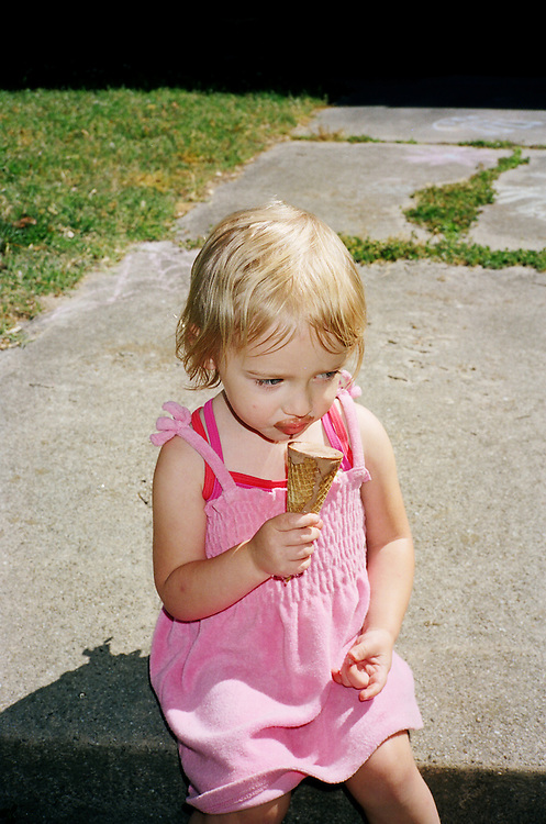 Madelyn Avery Eich, 2, devours an ice cream cone while sitting in front of her house in Norfolk, Virginia on Wednesday, May 12, 2010.