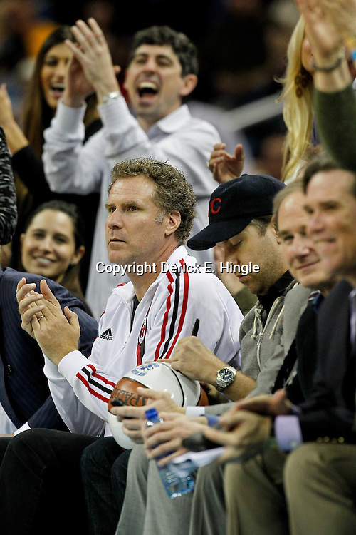 January 27, 2012; New Orleans, LA, USA; Actors Will Ferrell and Jason Sudeikis watch courtside during the first half of a game between the New Orleans Hornets and the Orlando Magic at the New Orleans Arena. The Hornets defeated the Magic 93-67.  Mandatory Credit: Derick E. Hingle-US PRESSWIRE