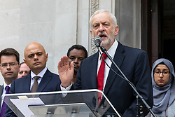 © Licensed to London News Pictures. 19/06/2018. London, UK. Labour Party Leader Jeremy Corbyn (centre) joins politicians, community and faith leaders, and members of Islington Council for a minute's silence on the steps of Islington Town Hall to mark the first anniversary of the Finsbury Park Attack. Photo credit: Rob Pinney/LNP