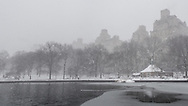 The Sailboat Pond in Central Park during a snow storm.