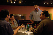 Agaveros Restaurant owner Rafael Garcia chats with customers on Saturday night, Oct. 11, 2009..
