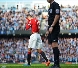 MANCHESTER, ENGLAND - Sunday, November 2, 2014: Manchester United's Chris Smalling walks off dejected after receiving a second yellow card and then a red card during the Premier League match against Manchester City at the City of Manchester Stadium. (Pic by David Rawcliffe/Propaganda)
