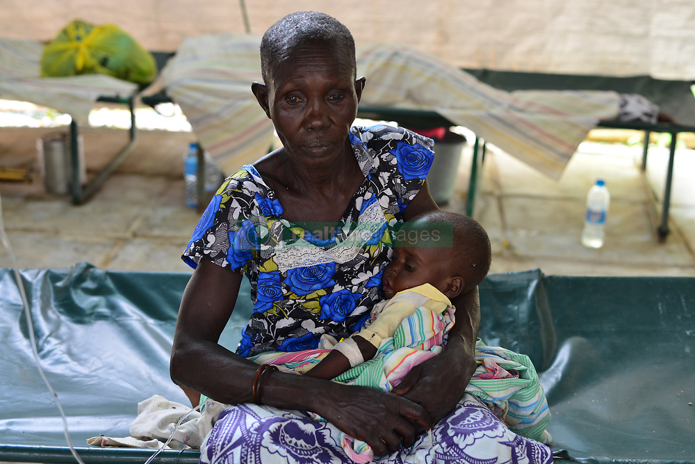 June 28, 2017 - Juba, Jubek, South Sudan - Christine Abel, 2, who suffers from malnourishment and a severe case of cholera, is held in the arms of her Grandmother Maria Apoco Wednesday in the General Hospital In Juba, South Sudan, where more than half the population is suffering from a severe humanitarian crisis including near-famine.Baby Christine lost her parents during a fighting between Government forces and rebel factions in the town of Gumbo in April.They live in the Don Bosco refugee camp. (Credit Image: © Miguel Juarez Lugo via ZUMA Wire)