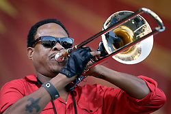 01 May 2015. New Orleans, Louisiana.<br /> The New Orleans Jazz and Heritage Festival. <br /> Corey Henry with Galactic on the Acura stage.<br /> Photo; Charlie Varley/varleypix.com