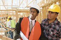 Architect and construction worker standing on construction site