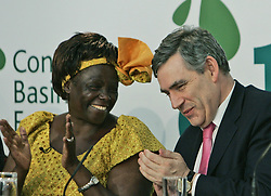 Prime Minister Gordon Brown, right, laugh with Nobel prize winner professor Wangari Maathai, left, during the launch of the Congo Basin Forest Fund at Lancaster House in central London.