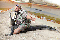 "Alligator wrestler Jonathan ""Cattail"" Vazquez performs his alligator exhibition show at Jungle Queen Tropical Isle in Fort Lauderdale on August 8, 2014. Photo/Cristobal Herrera Ulashkevich"