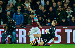 LONDON, ENGLAND - Saturday, November 4, 2017: Liverpool's goalkeeper Simon Mignolet tackles West Ham United's Manuel Lanzini during the FA Premier League match between West Ham United FC and Liverpool FC at the London Stadium. (Pic by David Rawcliffe/Propaganda)