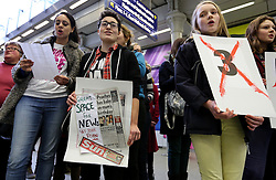 © Licensed to London News Pictures. 15/02/2014. London, UK. People from the 'No More Page Three' campaign perform a flash mob song at St Pancras Station in London on 15th February 2014. The No More Page Three campaign is asking The Sun newspaper to stop using topless female models on Page 3 of the daily British newspaper. Photo credit : Vickie Flores/LNP